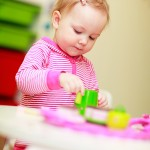 bigstock_Little_Girl_Playing_With_Toys_7464236